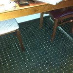 This was the tiny kitchen table and mismatched chairs (one a folding chair) note holes in uphols