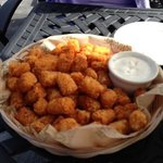Spicy tator tots on outside rooftop eagle nest lounge