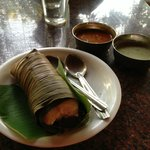 Steamed Idli wrapped in Plantain Leaves