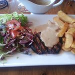 Fillet steak with pepper sauce, chips and salad