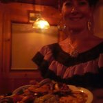 Our waitress with fajitas platter