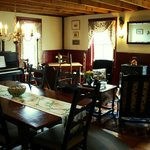  Our sunny dining room features a Yamaha piano and cozy wood stove.