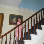  A formal pose on the staircase of Cook Mansion