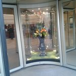  Fresh Flower arrangement inside glass Entrance door