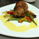Roasted monk fish wrapped in pancetta with a beurre blanc sauce