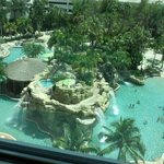This pool has a slide, bar, and two beach like areas! Towels provided. So relaxing.