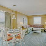  Oceanfront suite features dining area, bedroom, kitchen and living room.