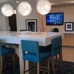 Breakfast/Lobby Area has a wonderful raised table with multiple electric/USB outlets.