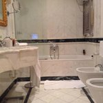 Marble bathroom with TV