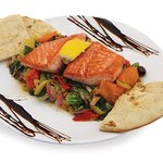 Salmon over oven sautéed veggies, served with pita bread