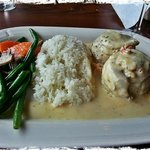  Flounder wrapped with crab meat, a light cream sauce and rice