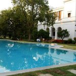 The pool at The Pataudi Palace shines under the Bright Sun