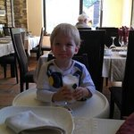 my kid taking lunch at hotel's reataurant