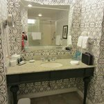 Bathoom mirror and sink in Superior Kings Suite