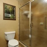  King Bed Guest Room standing tile shower with glass doors