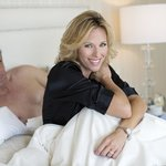 Couple In Bed Woman Watch