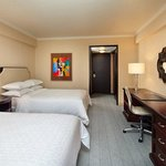  Club Double Queen Beds Guest Room