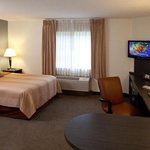 Studio Suite featuring one queen bed, full kitchen, flat screen TV
