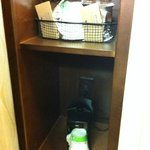 single-serve coffee maker and supplies (in shelves behind bathroom door)