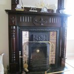 The fireplace in the parlor.