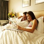  Couple relaxing in Guest Room