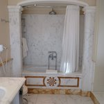 Large soaking tub for two with a rain shower