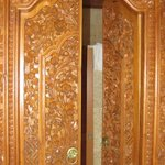 Beautiful wood carvings on the bathroom door