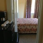 Family suite 2nd bedroom with queen, room 24.  Hallway with fridge and microwave, joining bathro