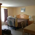 Family suite main bedroom, room 24.  King size bed, rollaway, pack n play, and table.