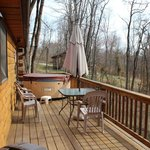 Back porch with hot tub. I'm sure it would be more secluded in the summer.