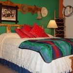  Buck-a-roo room with hand carved King bed