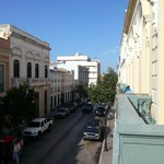  View from the balcony/ this street is full of bars