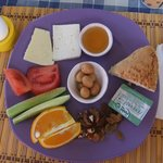 Breakfast - cheeses, honey, olives, fruits and types of  breads