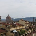  view towards Ponte Vecchio from rooftop terrace in the morning