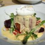 Wild mushroom risotto wrapped around mozerlla deep fried with a poached egg and hollandaise sauc