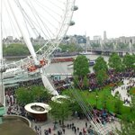 view from side room of wheel, jubilee gardens and river thames pageant