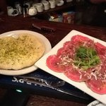 Carpaccio on a bed of mixed greens, drizzled with balsamic and olive oil - super yum!