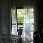 Mosquito nets give a safari feel to modern room