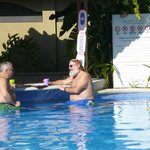 ENJOYING POOLSIDE BAR AND BACKGAMMON