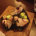 Nori cracker with hamachi and avocado