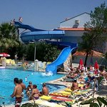 Pool area and slide, great holiday!