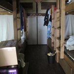  the very dark mixed dorm. (luggage storage below the bunk beds)