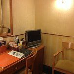 Desk, TV and minibar in room