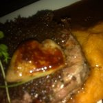 Beef fillet With Kalahari truffles, duck foie gras, smoked potato mash & dark red wine sauce