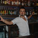 Bar man Ali having a dance.