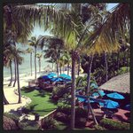 View overlooking the pool, beach and tiki bar from my suite