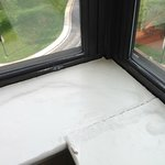The rotten window sill and the 1990's double glazing