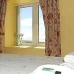  Auld Smiddy Cottage Bedroom with view to the Mull of Galloway and the sea