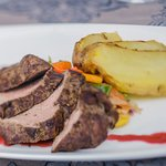 Idno lamb with baked potatoes