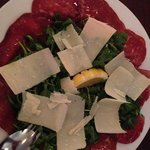  beef carpaccio with arugula with olive oil and Parmesan cheese. Yum!